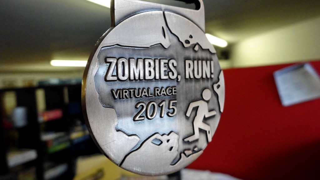 A medal with a running figuresaying 2015