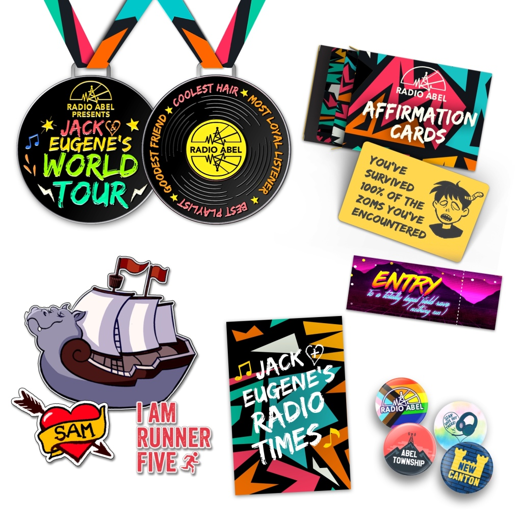 Jack & Eugene's World Tour reversible medal, affirmation cards, ticket stub, four button badges, flyer, and temporary tattoos